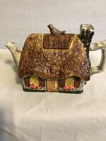 Russ Berne -  Tea Pot -  Cottage With Bicycle And Bird On Roof
