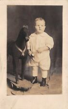 2 YEAR OLD BOY POSING WITH HIS TOY HORSE ON WHEELS, REAL PHOTO PC, dated 1916