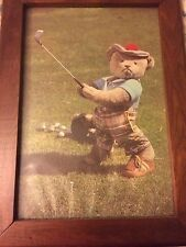 old picture of teddy bear golfing