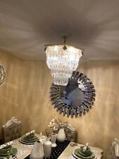 7- light tiered chandelier lighting used some wears