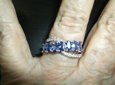 Ring--Tanzanite and white topaz curve--in silver, sz 7