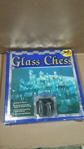 Elegant GLASS CHESS SET: clear and frosted pieces, smoked glass board
