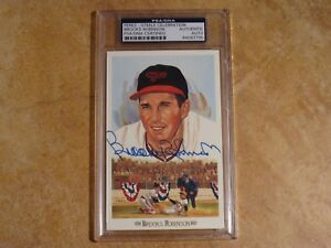 BROOKS ROBINSON HOF/89 PEREZ STEELE CELEBRATION SIGNED AUTOGRAPH POSTCARD PSA