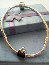 Silver Charm Snake Bracelet.