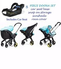 NEW Doona 5 Pc Set - CAR SEAT + base, raincover, sunshade and snap on storage