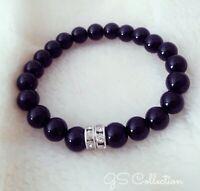 Black Onyx Bracelet with Silver two  CZ rondelles .