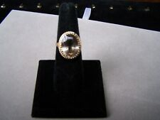 LARGE MID-CENTURY OVAL SMOKY TOPAZ SOLITAIRE & 10K YELLOW GOLD RING