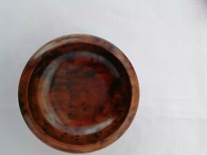 Small wooden bowl. Handcrafted from Thuya Wood hard and Burrl Wood very tactile.