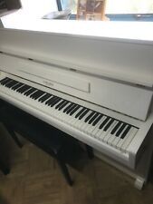 upright piano in white, second hand, very good condition, fully serviced