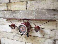 Red vintage aeroplane clock and shelf wall unit display