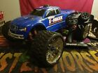 traxxas emaxx brushless edition 6s castle tqi 4ch 2.4ghz belted tire wheelie bar
