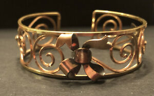 Vintage signed Krementz USA gold brass tone cuff bracelet swirls flowers ribbon