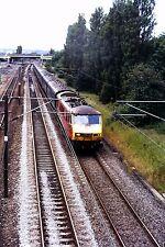 Original Slide,Class 90 90029 passing Tyne Yard with green mk1 stock 6/7/2002