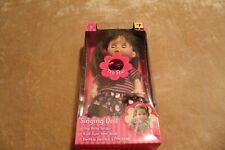 singing doll brown hair girl