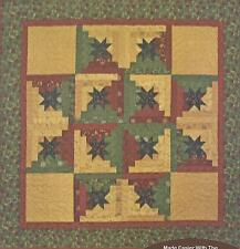 Yule Log Cabin Star Table Topper quilt pattern by Raggedy Ruth Designs