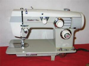 HEAVY DUTY WHITE SEWING MACHINE model 564.  All Metal