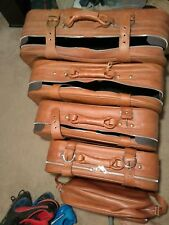A VINTAGE NESTING SET OF 5 SUITCASES!!! POSSIBLY REAL LEATHER- THERE READ TO USE