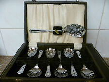 A VINTAGE, SEVEN PIECE CANTEEN OF CHROME PLATED RIBBON & BOW DESSERT SPOONS