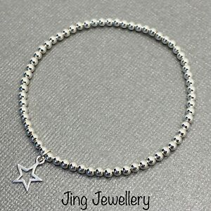 Sterling Silver Stretch Beaded Stacking Bracelet With Open Star Charm 925