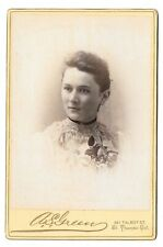 Lovely young woman with flowers - by A.S. Green of St Thomas, Ontario