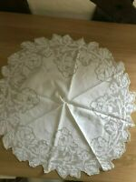 Small white circular tablecloth embroidered