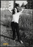 hippie girl smiling in strange jeans, Vintage Photograph, 1970 Milano, Italy