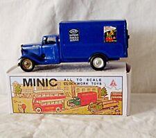 blue minic clockwork delivery van