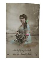 Postcard Beautiful Dutch Lady in Green with Flowers 1912? Vintage RPPC