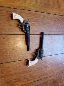 Two (2) Marx Miniature Six Shooter vintage Lead Toy Cap Revolver Pistols