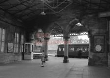 PHOTO  SUBURBAN UNIT PARTLY VISIBLE THROUGH THE PORTALS OF PERTH STATION 20/7/64