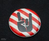 TGI Fridays Button Pin Hand Symbol For Rock and Roll Stripes 2009 Red and White