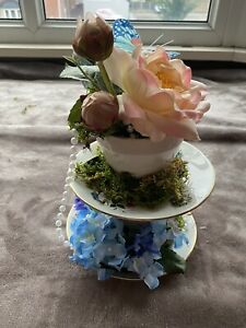 Wedding Table centrepieces Complete With Flowers. Alice In Wonderland.
