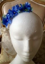 Pretty blue flowered fascinator on a silver headband! Easy to wear and gorgeous!