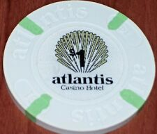 $1 1ST EDITION GAMING CHIP FROM THE ATLANTIS CASINO IN ATLANTIC CITY