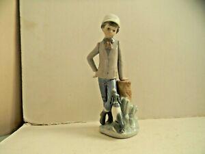 NAO BY LLADRO BOY WITH DOG FIGURINE