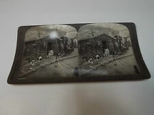 ESKIMO ESQUIMAUX AND DOG TEAM BEFORE A KLONDIKE MINER'S CABIN STEREOVIEW CARD