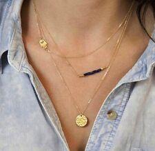Bijou fantaisie , collier triple chaines dorées , main, disque et perles bleues