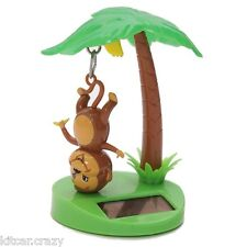 NOVELTY SOLAR POWERED HANGING MONKEY IN PALM TREE, DASHBOARD TOY, HOME OR CAR