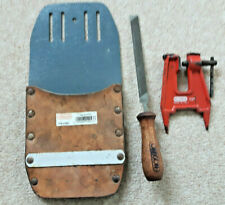 JOB LOT OREGON CHAINSAW TOOLS. VICE,TOOL HOLSTER AND A FILE.