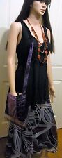 Ladies made in Australia Black stretchy sleeveless top size 14 with ties to back