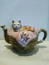 Cat Lovers, Teapot Lovers.  Stunning Kitty on a Pink Blanket on A Wicker Teapot.