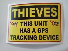 THIEVES < this unit has a GPS tracking device decal sticker / machinery / window