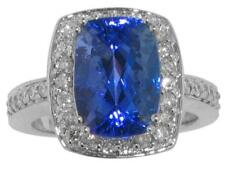 8.37 Ct. TW Cushion Cut Tanzanite in Round Diamond Halo Accented 14 kt. Ring