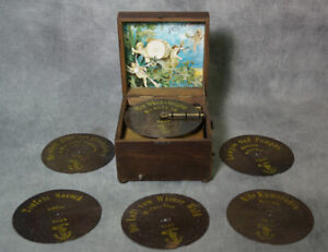Antique 1890 Polyphon Disc Music Box.  You can see and hear me play !