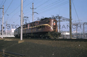 Original slide: PRR Tuscan Red GG1 w/1960 ARMY-Navy Game Special; 11/26/1960