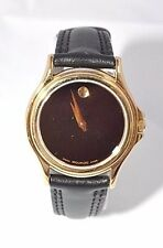 W317- Womens  Swiss Movado Museum Folio Black Museum Dial Leather Gold Watch