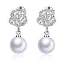 Boucles d'oreilles en argent avec des perles roses