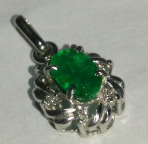 Solid platinum natural emerald and diamond pendant 1.56 grams