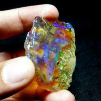SEE VIDEO 199 Cts NATURAL AAA+WELO FIRE ETHIOPIAN OPAL ROUGH(50x45x22MM)Z124