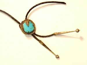damaged bolo tie with turquois stone in a silver colored slide  (cord broken)